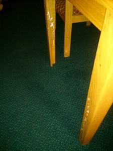 the damaged table legs